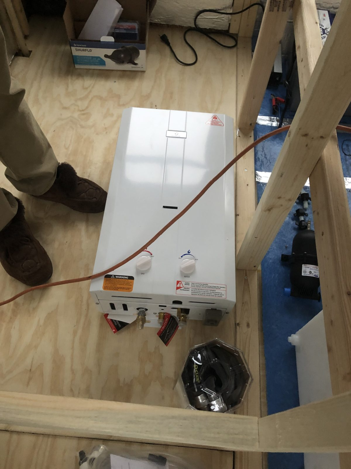 The tankless hot water heater is large and heavy