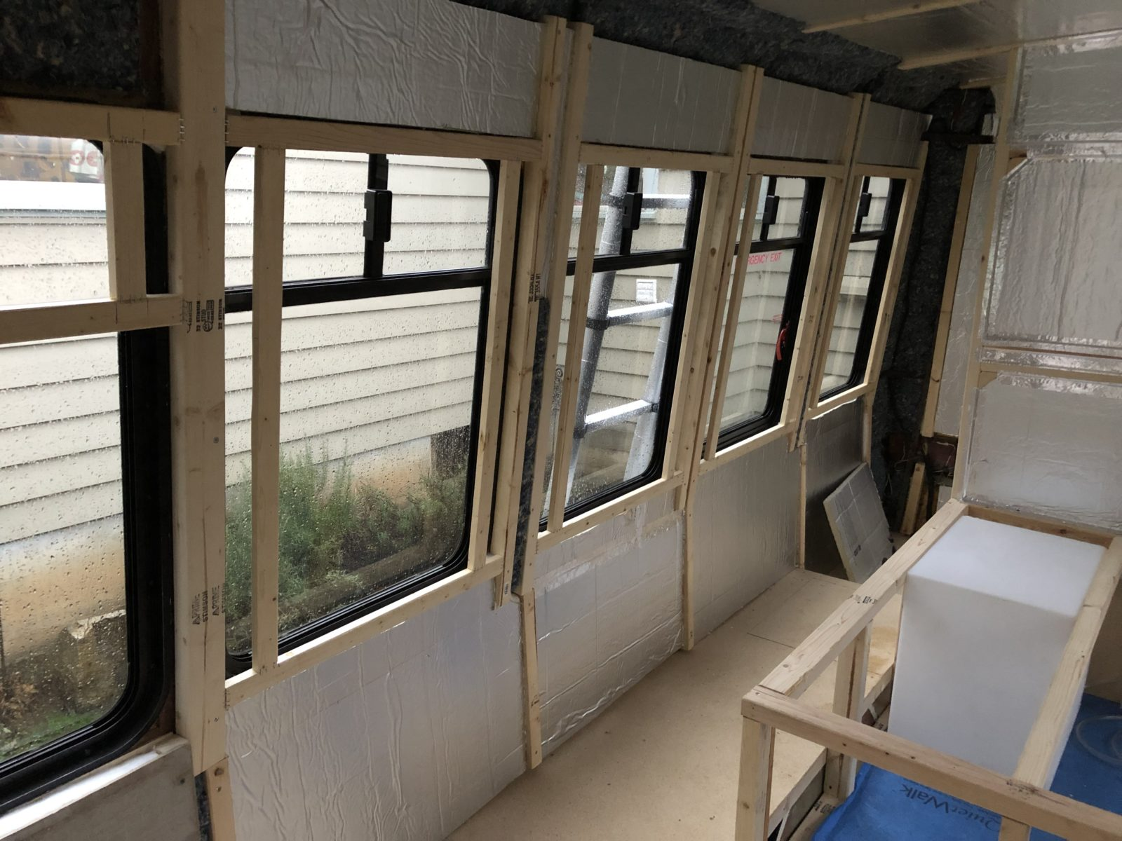 Framing rounded windows on a shuttle bus conversion